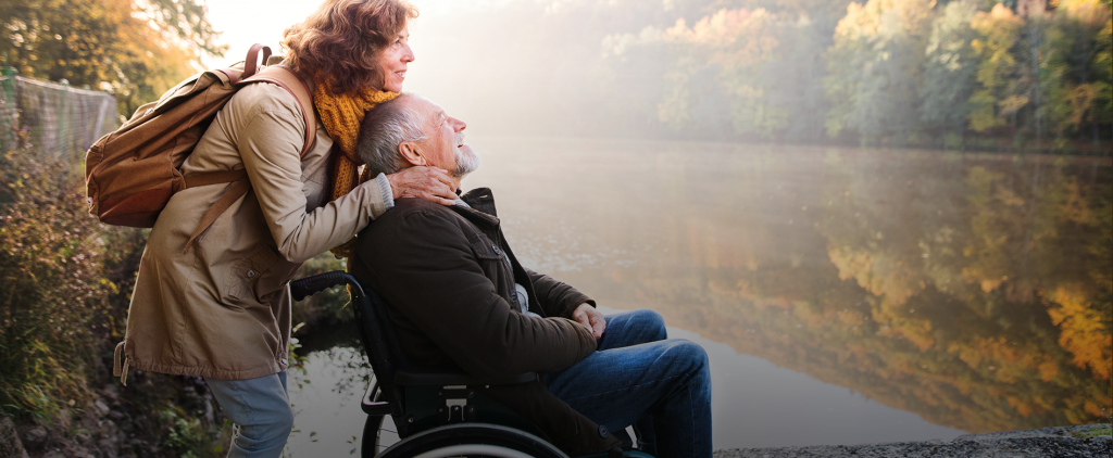 senior-couple-with-wheelchair-in-autumn-nature-5WHMCX8 copy